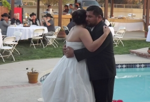 The bride and groom have first dance