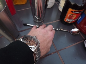 Reaching for the tools of the trade with a boss watch on!