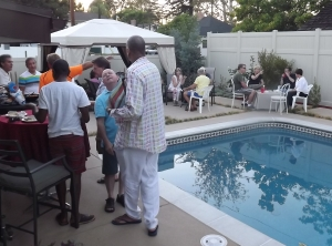 Guests mingling beside pool