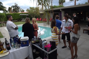 Guests mingle poolside