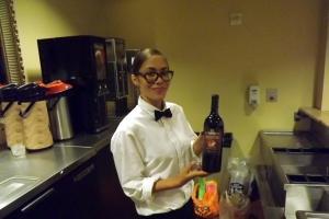 Bartender modeling wine