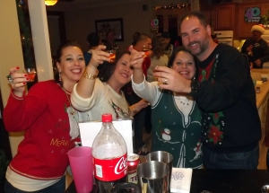 Tacky sweater contestants enjoy shots
