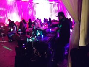 DJ Benny Boom spins inside tent
