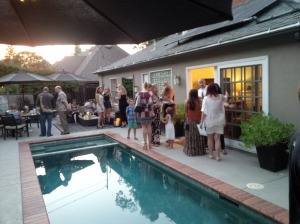 Guests mingle poolside in Sherman Oaks