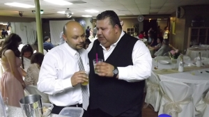 The fathers share a drink