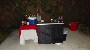 Portable bar and table at holiday party